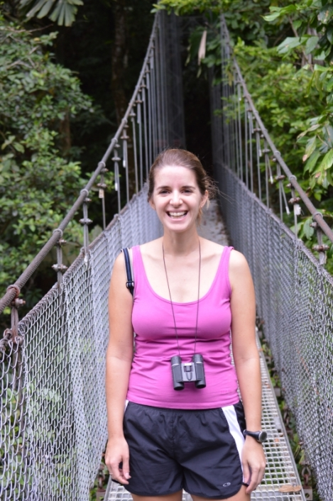 Jenn on a hanging bridge in the rainforest in Costa Rica